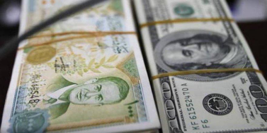 Li Rojavayê Kurdistanê dolar asta 900 lîreyên Sûrî derbas kir